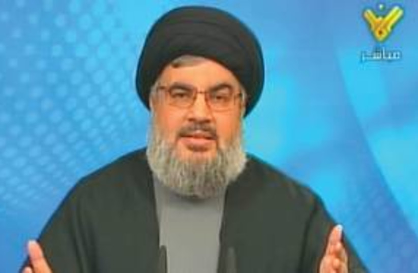 Hezbollah's Hassan Nasrallah 311 (R) (photo credit: Reuters)