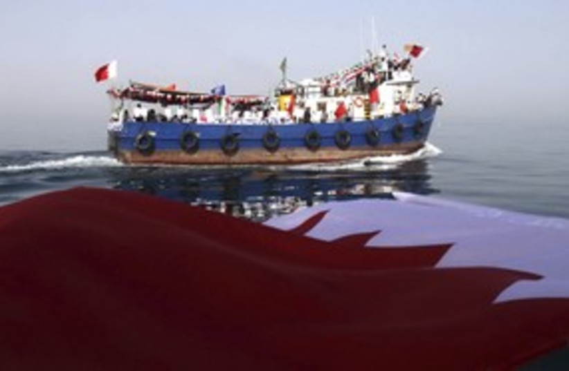 Bahrain flag and boat 311R  (photo credit: Reuters)