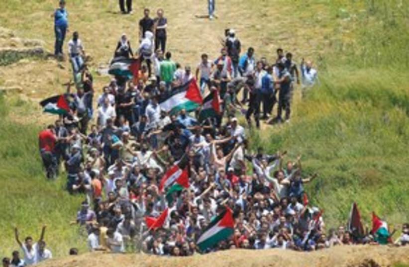 naksa day clashes_311 reuters (photo credit: Ronen Zvulun/Reuters)