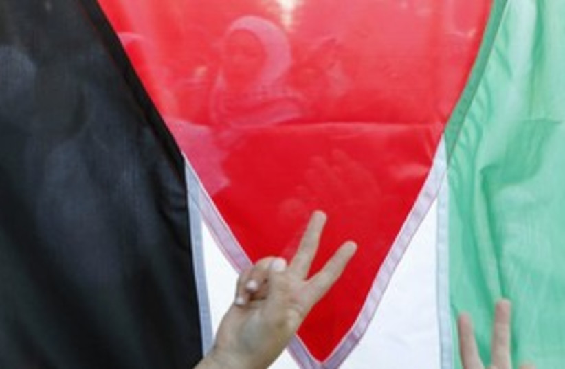 palestinian flag_311 (photo credit: REUTERS/Ali Jarekji)
