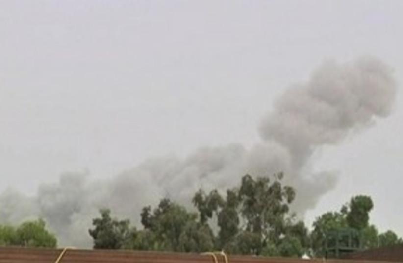 gaddafi compound blast_311 (photo credit: REUTERS)