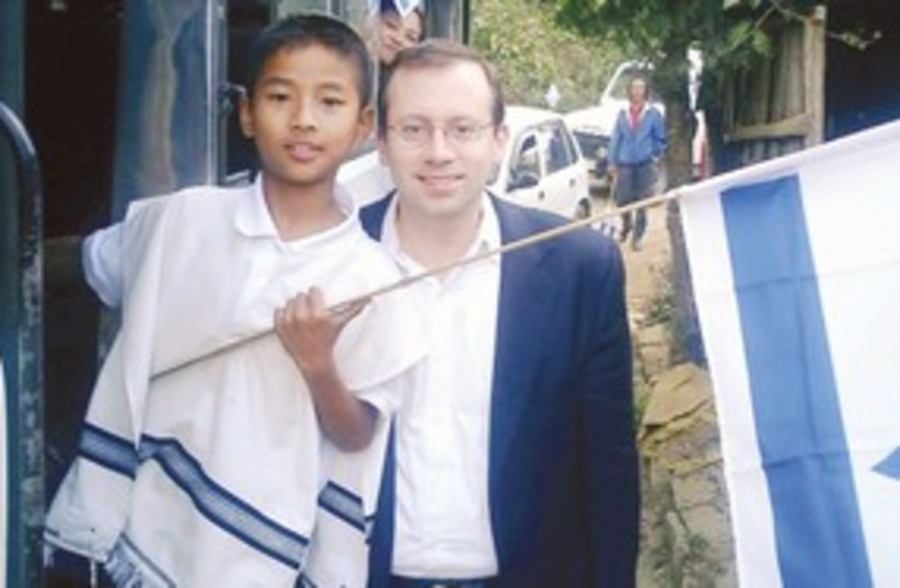 Freund with a Bnei Menashe youth in India 311 (photo credit: MICHAEL FREUND)
