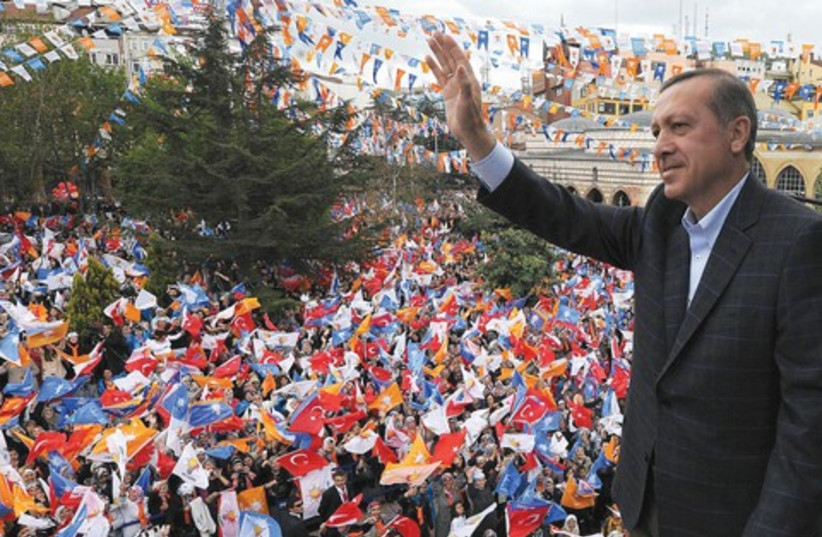 Turkish Prime Minister Recep Tayyip Erdogan 521 (R) (photo credit: Reuters)