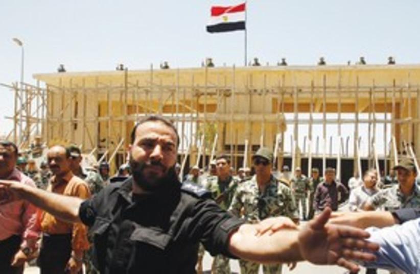 Hamas police at the Rafah border to Egypt 311 (R) (photo credit: Reuters)