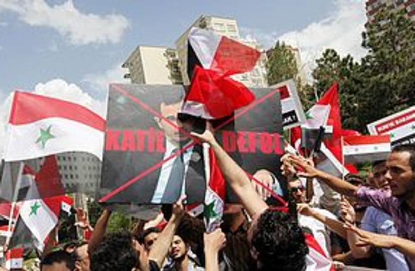 Syrians protest Assad 311 (photo credit: REUTERS)