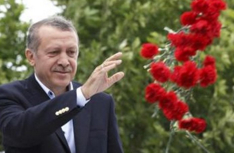 Tayyip Erdogan throws flowers at his supporters