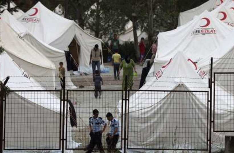 Syrian refugee camp in Turkey 521 (photo credit: REUTERS/Osman Orsal)