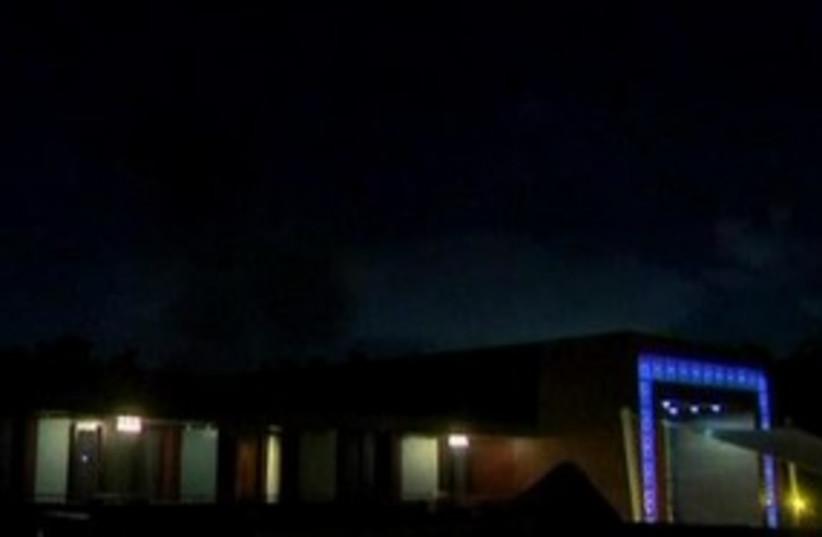 Smoke rising above the Gaddafi compound (photo credit: Reuters)