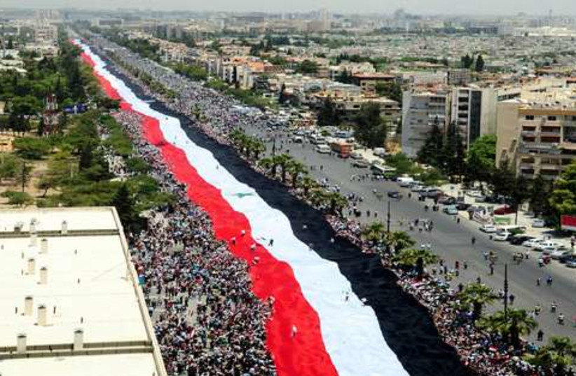 Syria flag demonstration 521 (photo credit: REUTERS/Sana Sana)