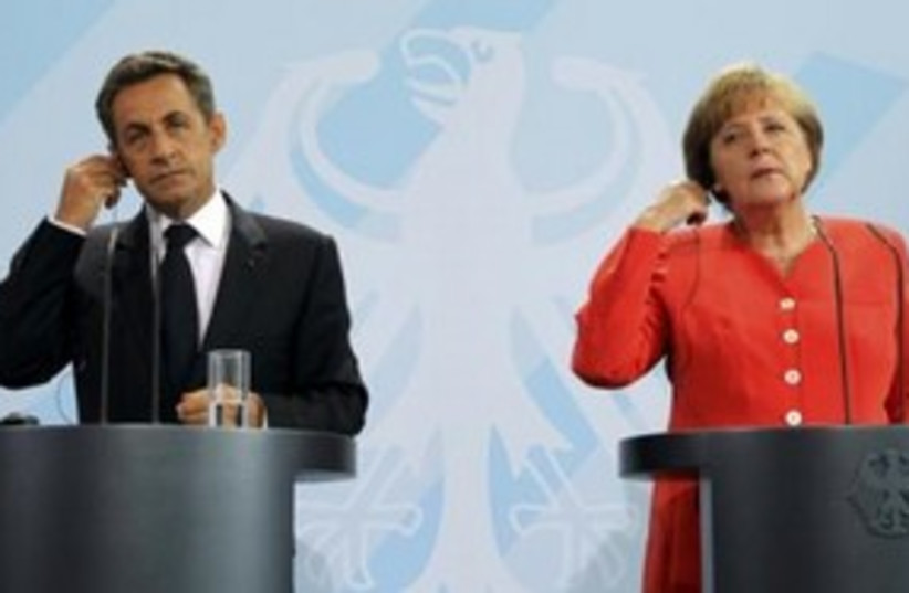 German Chancellor Merkel and French President Sarkozy 311 (R (photo credit: REUTERS)