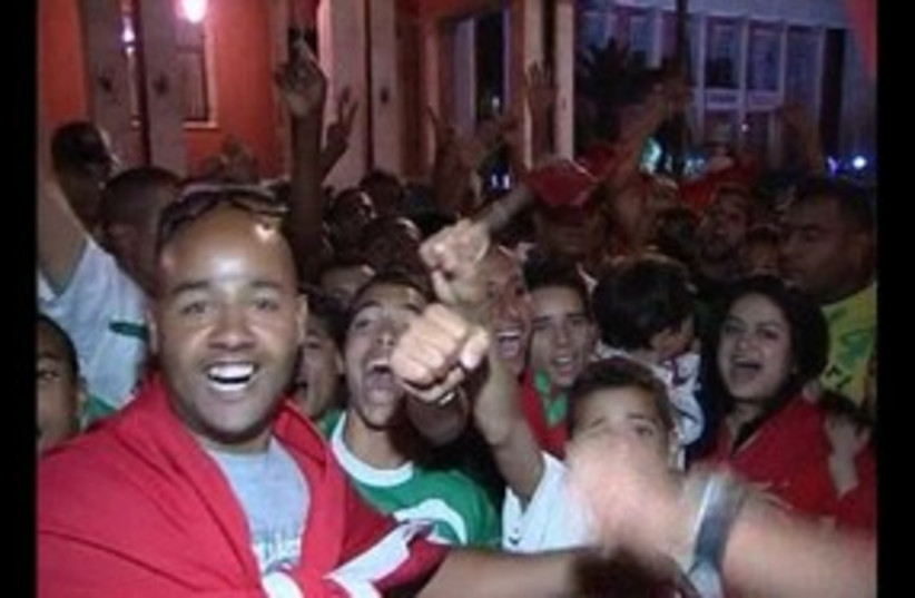 Moroccans celebrate constitutional reforms 311 R (photo credit: REUTERS)