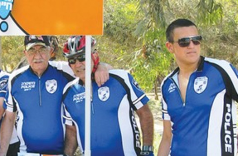 VOLUNTEER CYCLISTS prepare to police streets of Yeroham 311 (photo credit: Courtesy: Israel Police)