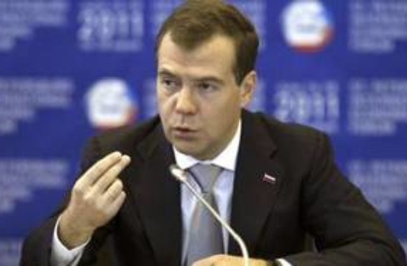 Russian President Dmitry Medvedev 311 (R) (photo credit: REUTERS/Alexander Demianchuk)