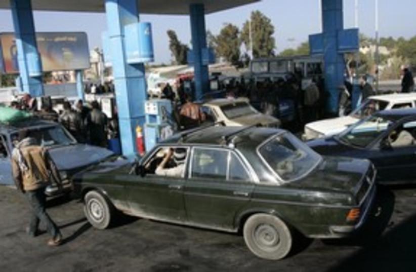 Gazans buy gasoline in Rafah 311 (R) (photo credit: Nasser Nuri / Reuters)