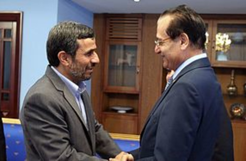 Ahmadinejad and Mansour 311 (photo credit: Press TV)