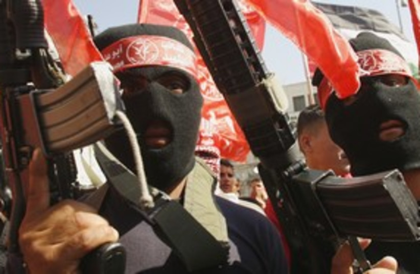 Palestinian PFLP terrorists with guns in Nablus 311 (R) (photo credit: Abed Omar Qusini / Reuters)