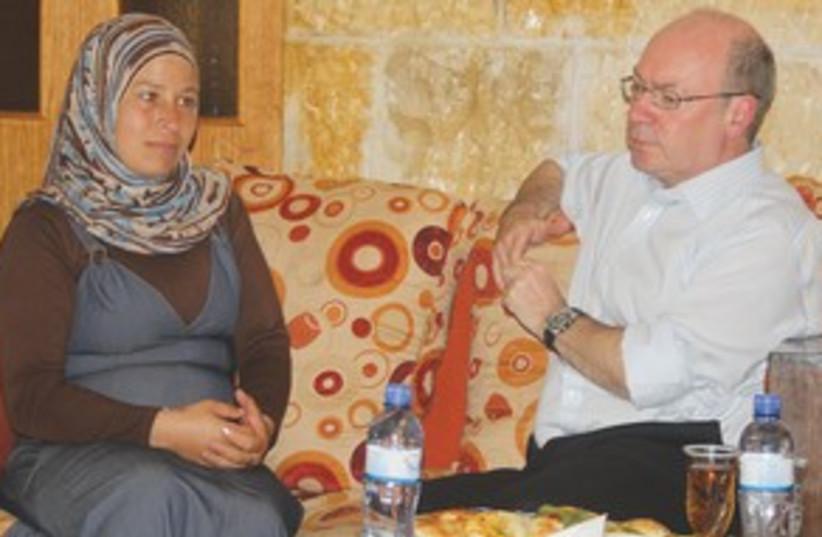 Alistair Burt speaks with the wife of protest activist Bassa (photo credit: Tovah Lazaroff)
