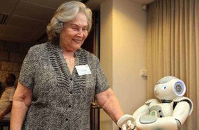 Prof. Ruth Arnon with a robot 311 (photo credit: Sasson Tiram/Israel Academy)