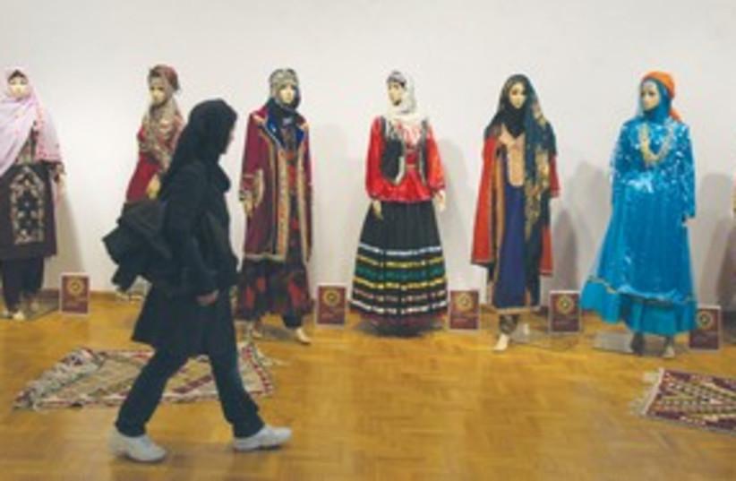 Iranian student walks past mannequins (photo credit: REUTERS)