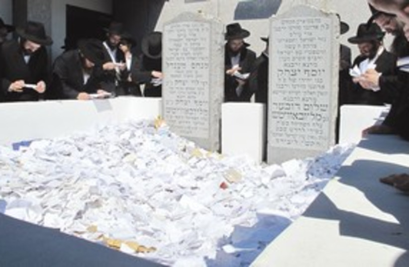 Scraps of paper at Rabbi Schneerson's grave 311 (photo credit: Gil Shefler)