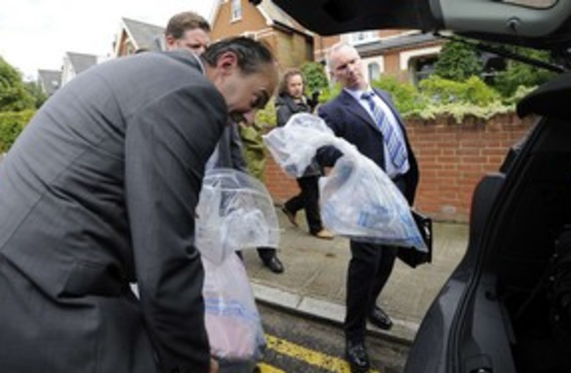 uk POLICE, HOME OF HANDY COULSON_311 (photo credit: REUTERS)