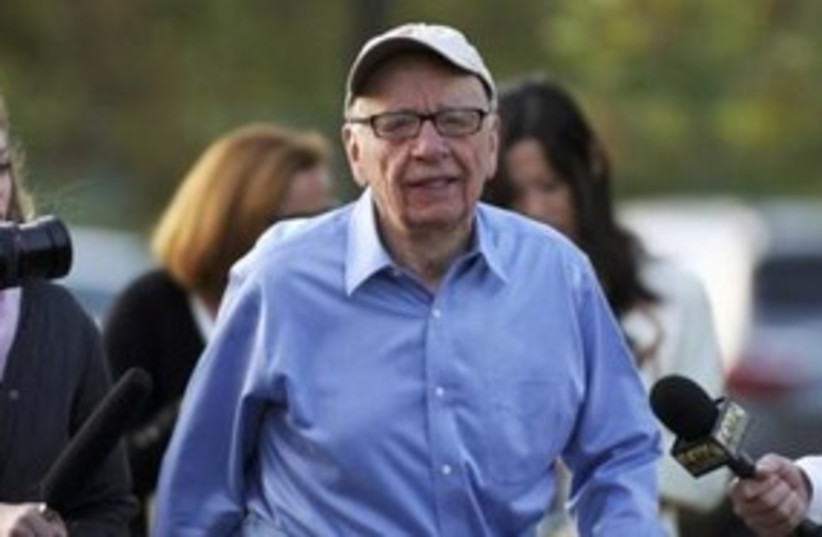 Rupert Murdoch with press 311 (photo credit: REUTERS/Anthony Bolante)