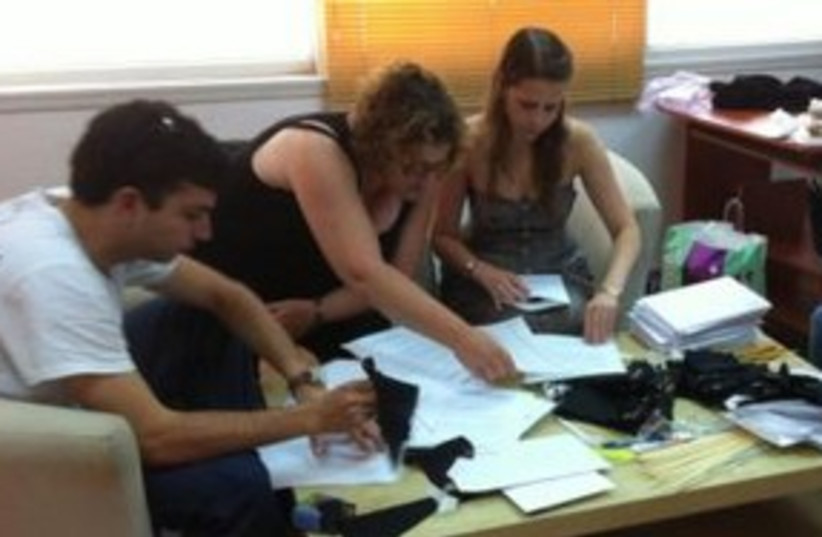 Peace Now members preparing black flags for MKs 311 (photo credit: Courtesy)