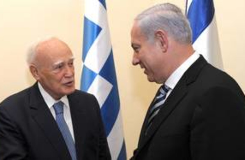 netanyahu and Papoulias_311 (photo credit: Amos Ben Gershom/GPO)