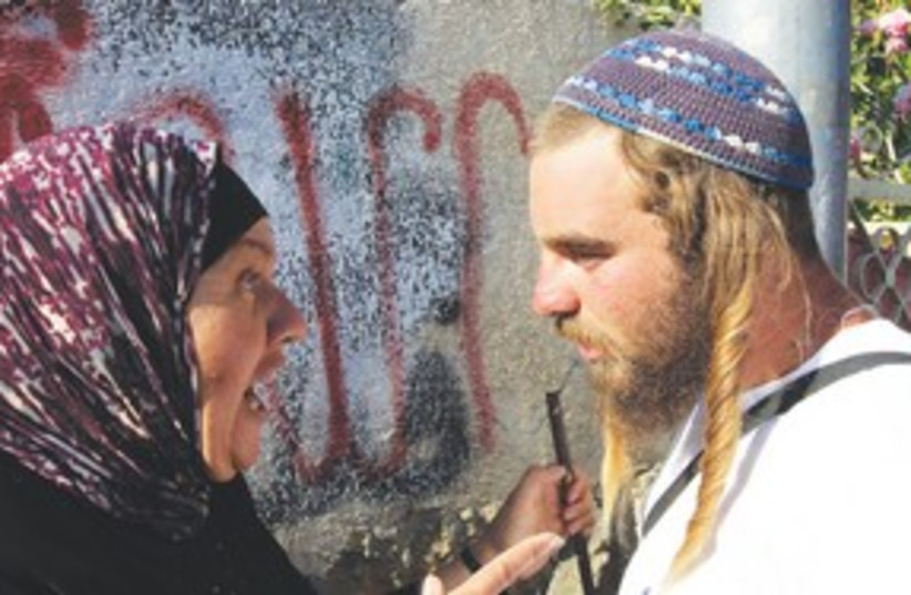 Confrontation between Palestinian woman and right wing man (photo credit: REUTERS)