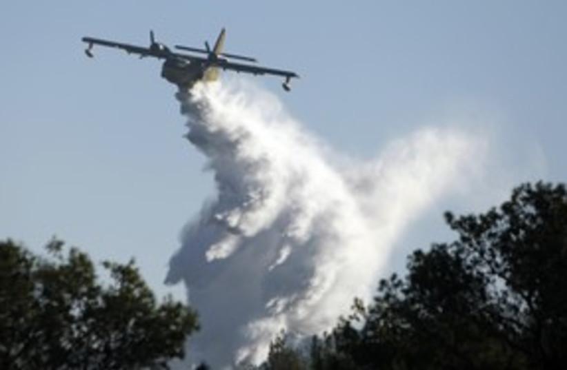 fire 311 R (photo credit: REUTERS)