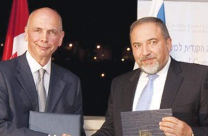 FM Lieberman and Canadian Ambassador Paul Hunt 311 (photo credit: Courtesy)