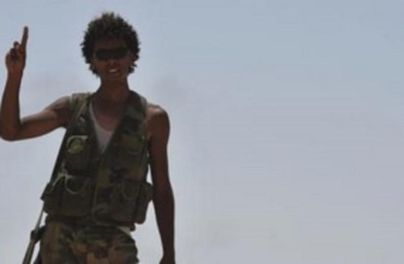 Libyan rebel on the front lines 311 (R) (photo credit: REUTERS/Esam Al-Fetori)