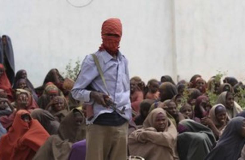 Al-Shabaab fighter at  food distribution camp Somalia 31 (R) (photo credit: Feisal Omar / Reuters)