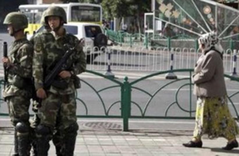 Chinese soldiers in Xinjiang 311 (R) (photo credit: REUTERS / Nir Elias)