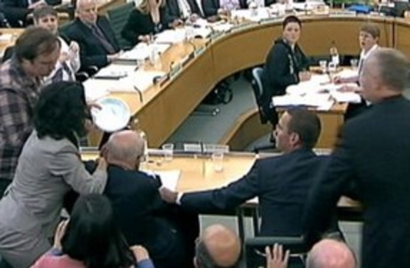 murdoch gets attacked_311 r (photo credit: REUTERS/Parbul TV)
