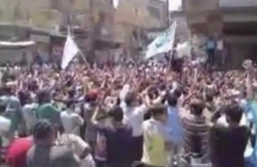 Demonstration in Syrian city of Hajar al-Aswad 311 (R) (photo credit: REUTERS)