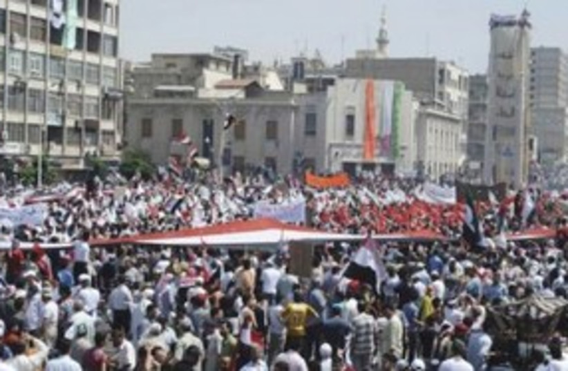 Anti-Assad protest in Syrian city of Hama 311 (R) (photo credit: REUTERS)