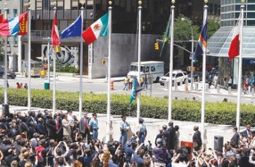 THE FLAG of South Sudan is raised in front of the UN head311 (photo credit: REUTERS)