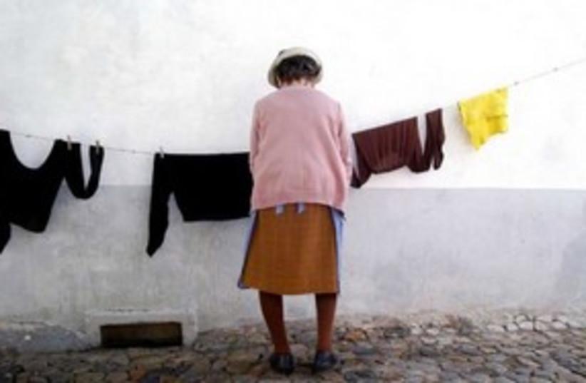 woman hanging laundry 311 (photo credit: Maxim Reider)