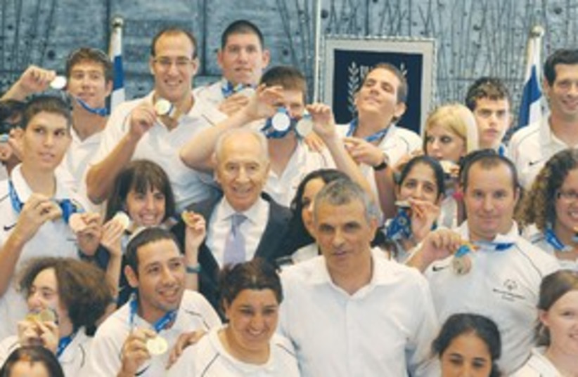 Peres with Special Olympics team 311 (photo credit: Greer Fay Cashman)