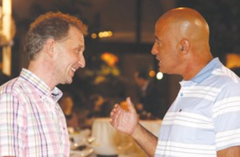 David Horovitz and 'Jerusalem Post' owner Eli Azur (photo credit: Marc Israel Sellem)