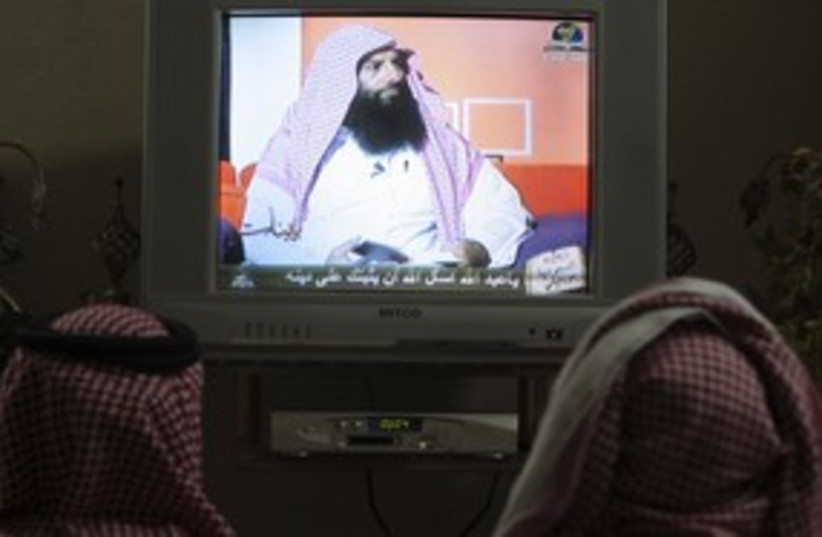 Saudis watching Ramadan television program 311 (R) (photo credit: Fahad Shadeed / Reuters)