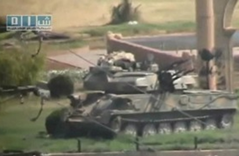 Tank sits in Hama, Syria_311 (photo credit: REUTERS)