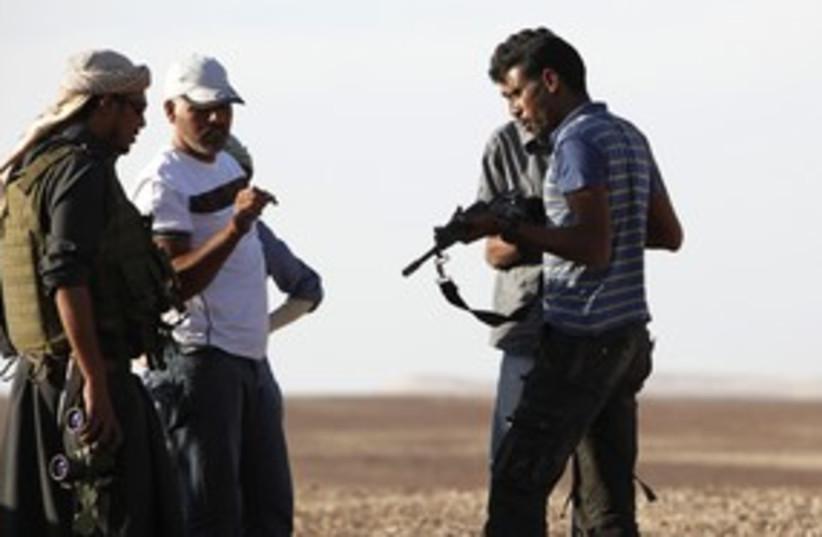 Sinai Bedouin guns pipeline_311 (photo credit: Reuters)