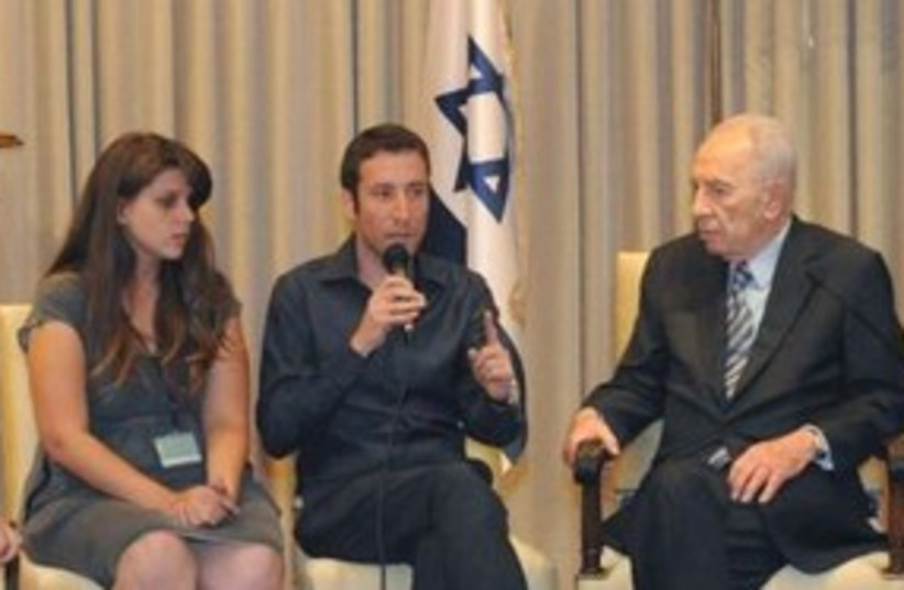 Peres and housing protest leaders_311 (photo credit: President's Office)