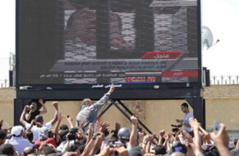 Mubarak trial on tv 311 R (photo credit: REUTERS/Mohamed Abd El-Ghany)
