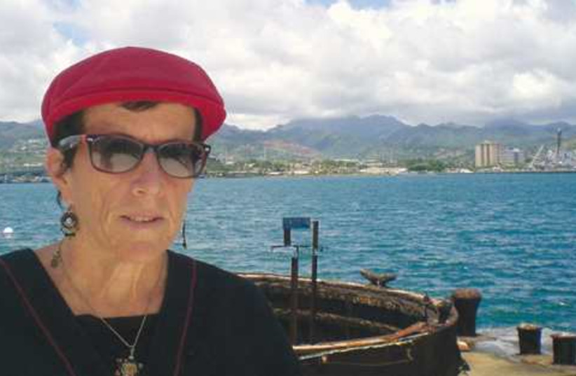 The writer in front of the USS Arizona memorial. (photo credit: Courtesy)