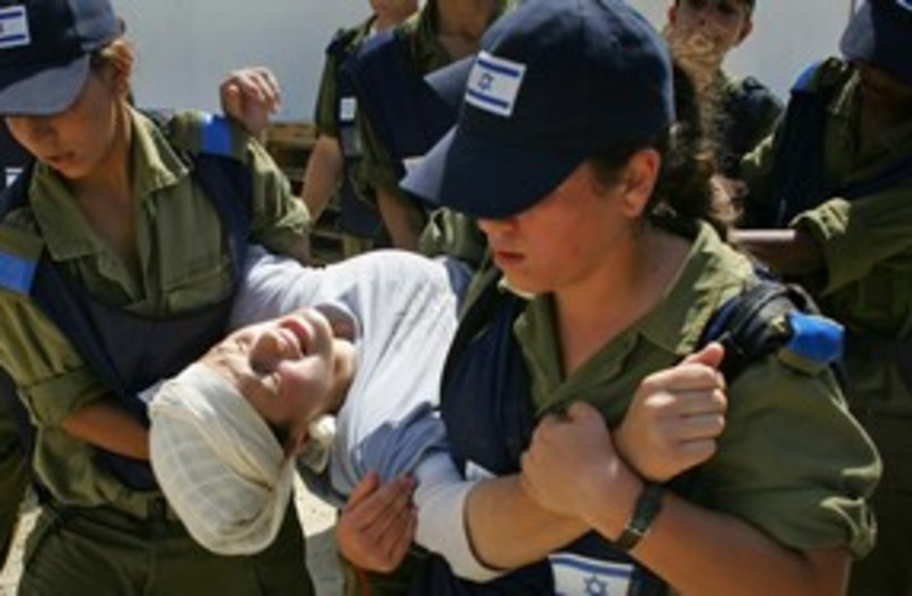 Gush Katif settlers are evacuated from Gaza 311 (R) (photo credit: Paul Hanna / Reuters)
