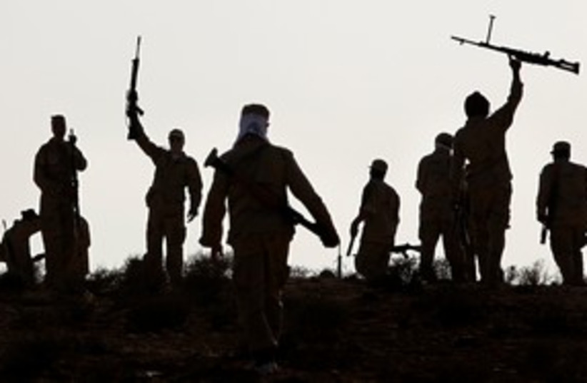 Libyan rebels during training exercise 311 (R) (photo credit: REUTERS/Bob Strong)