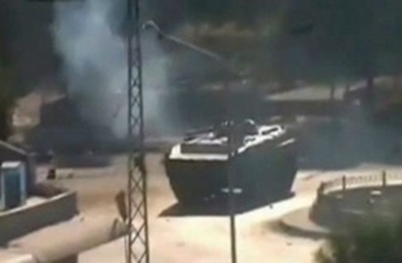 Syrian tank in Hama 311 (photo credit: Reuters)